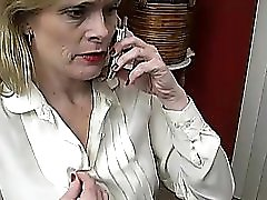 Sexy mature babe talks dirty on the phone while wanking