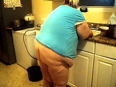 In the kitchen doing dishes