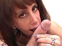 Skinny aging slutbag wraps her gross tits around white cock