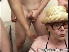 Nasty big boobed brunette slut sucking more than one bi