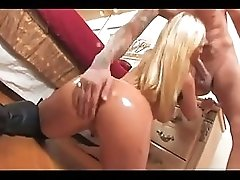 Blonde in leather boots fucked in her pussy
