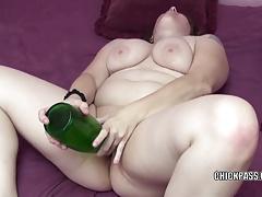 Plump MILF Alexsis Sweet stuffs her twat with a bottle