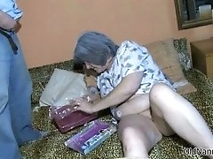 Nasty old slut gets horny rubbing a dildo on her pussy