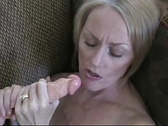 Mature woman satisfies herself with a dildo