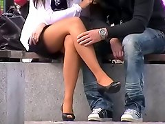 Sitting girl with sexy legs in miniskirt