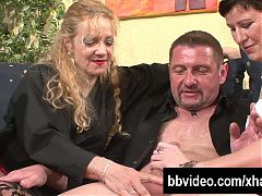 German couple fucking with a mature woman