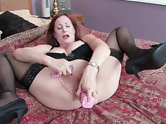 Randy MILF in stockings fucks her wet cunt with a toy
