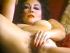 Mature brunette spreads her legs to rub her exposed pussy
