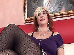 Mature slut in stockings fucked on the sofa