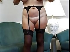 Chubby blonde granny strips and masturbates with cell phone