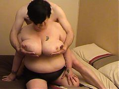 BBW has her huge breasts fondled and gives oral