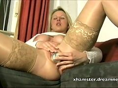 She Stuffs Beer Can In Her Pussy