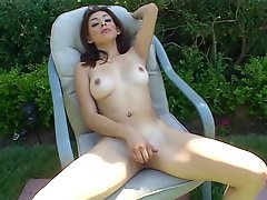 Gorgeous brunette masturbates outdoors