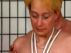 Horny blonde mature woman getting tied up to this chair