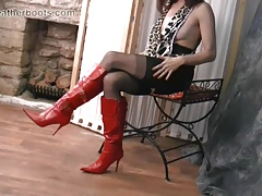 Sexy Milf teases in sheer nylon and slutty red leather boots